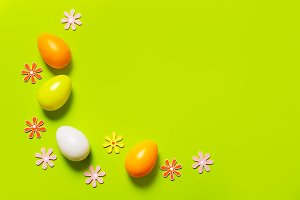 Easter decor on green background
