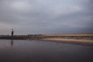 Dark Clouds over Beach at North Sea