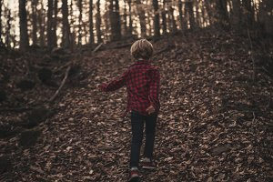 Boy Walking Through the Woods