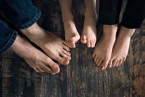 Bare feet of family members