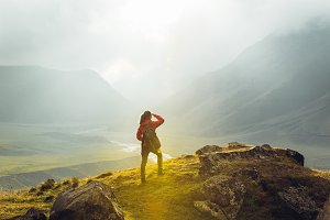 Young girl on foot hiker with a back