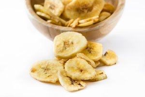 Banana chips in bowl isolated
