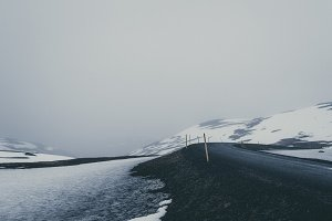 Foggy Winter Landscape with Road