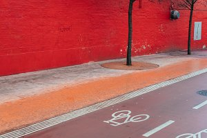 Dark Red Wall and Bike Lane