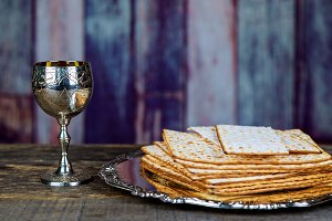Glass of Passover wine and matzah