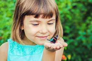 Child with a butterfly.