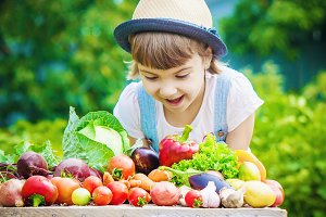Child and vegetables. Selective focu