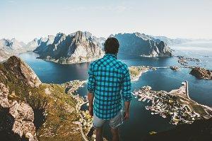 Traveler Man standing on cliff edge