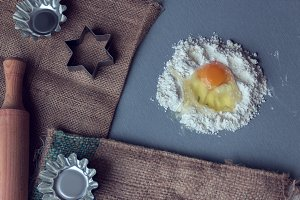 broken chicken egg into flour