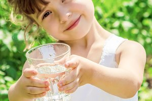child glass of water.