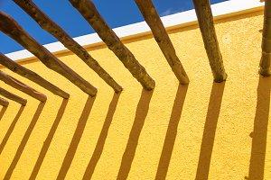 Wood Post Beams & Bright Yellow Wall