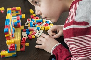 Child play with constructor toys