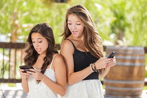 Two Girlfriend Using Smart Phones