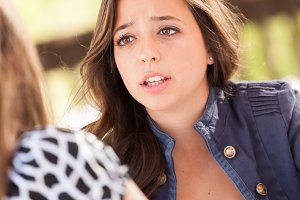 Concerned Young Adult Woman Talking