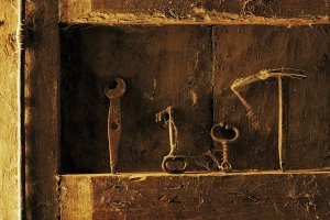 tools and utensils at antique door