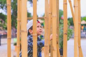 Exotic landscape - boy & bamboo