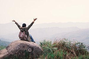 woman feeling exciting on top hill