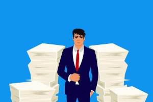 businessman between pile of papers