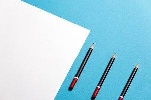 Black pencil lies on a clean white s