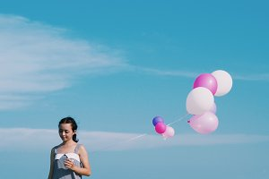 Asian woman with balloons