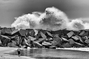 Big wave explodes against the rocks