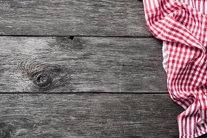 Red checkered textile on rustic wood