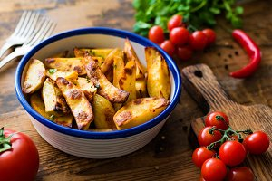 Spicy potato wedges in a bowl