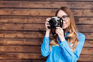 Happy young hipster woman in glasses