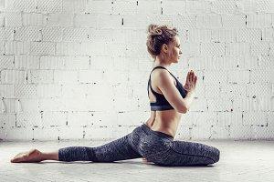 Sporty young woman doing yoga practi