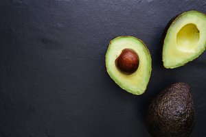 Avocado half dark background