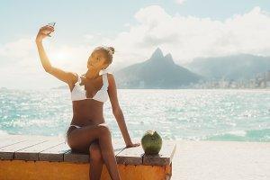 Girl on the beach is taking selfie