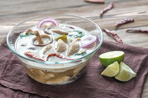 Glass bowl of thai tom kha kai soup