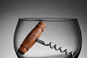 Old Cork Screw in Wine Glass