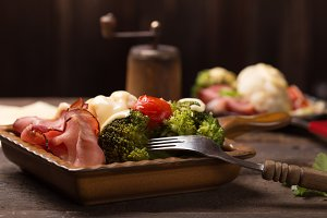 raclette with vegetables and bacon