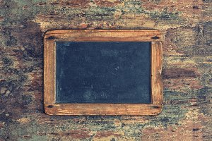 Antique chalkboard. Wooden texture