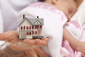 Couple & Baby and Small Model House