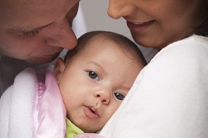 Mixed Race Couple with Newborn Baby
