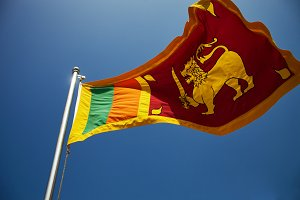 Sri Lanka flag against blue sky