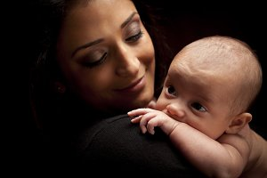 Ethnic Woman Holding Her Baby