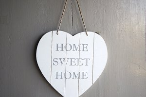 Wooden heart with home sweet home ha
