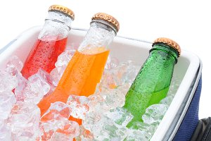 Closeup Soda Bottles in Ice Chest