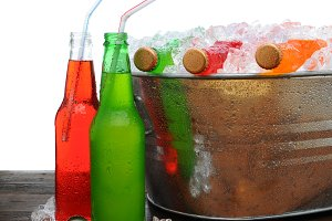 Bucket of Cold Sodas on Wooden Table