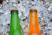 Two Soda Bottles on a Bed of Ice