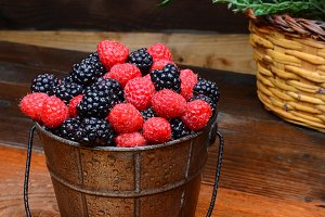 Berries in Pail on Rustic Wood Table
