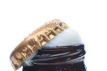 Closeup Frothy Beer Bottle Top