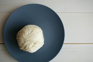 White yarn ball.