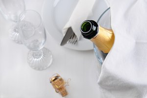 Champagne Bottle and Table Setting