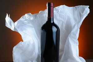 Red Wine Bottle and Tissue Paper