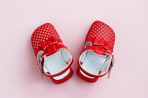 children's shoes on a pink backgroun
