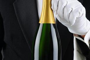 Sommelier Holding Champagne Bottle